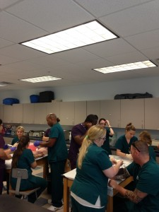RT and MA practicing phlebotomy Sept. 2014