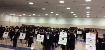 Grads lined up in Exhibit Hall (2)