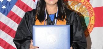 Iliana Ardila with diploma