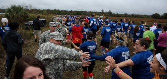 high fives with servicemembers