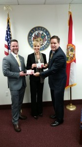 Fellows and Sen. Aaron Bean with his candybars
