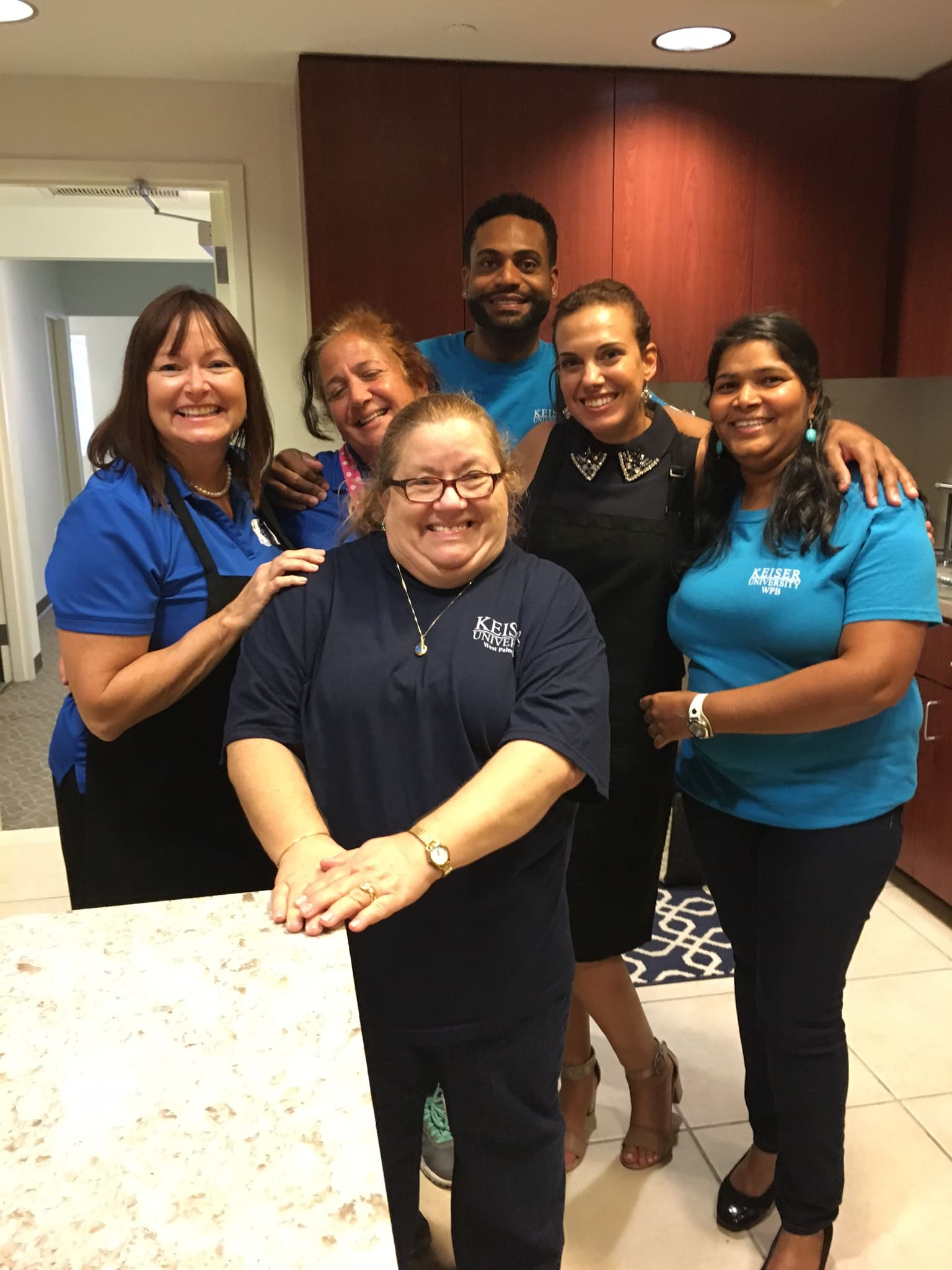 Faculty and Staff from the West Palm Beach Campus Volunteer at Quantum House