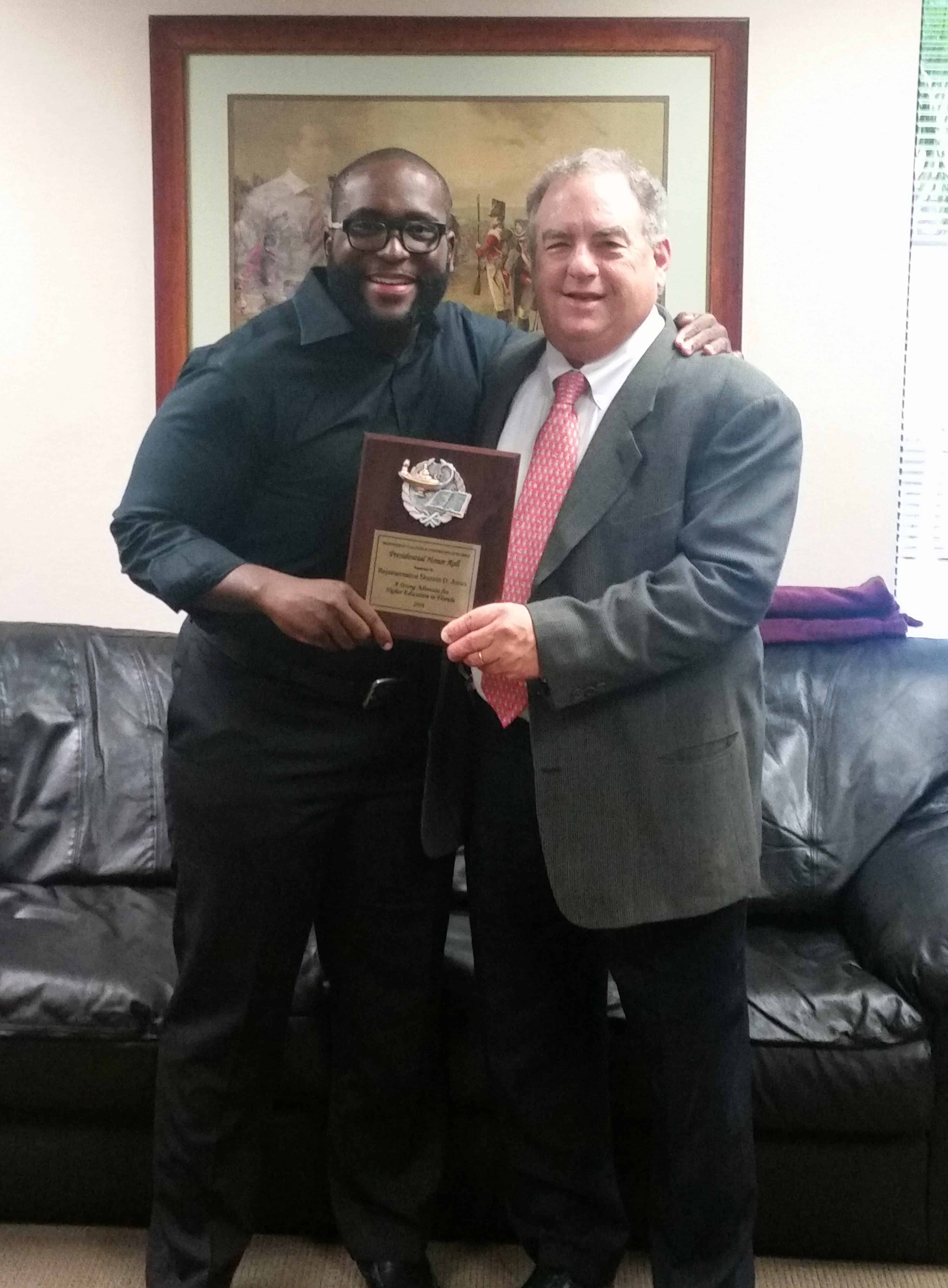 Dr. Keiser Makes a Presentation to Representative Shevrin Jones