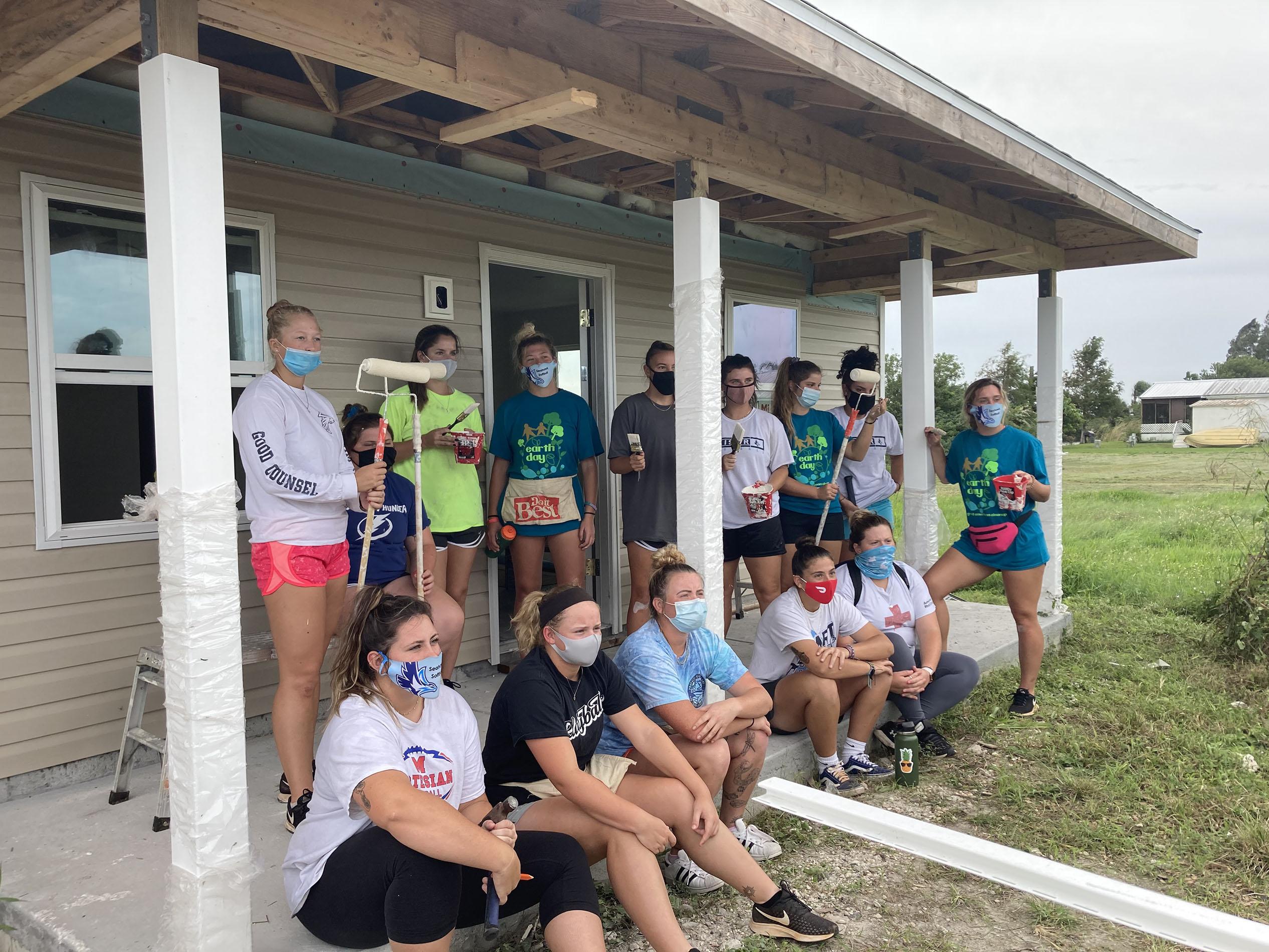 Seahawk Softball Team Members Roll-Up Sleeves for Volunteer Construction Effort